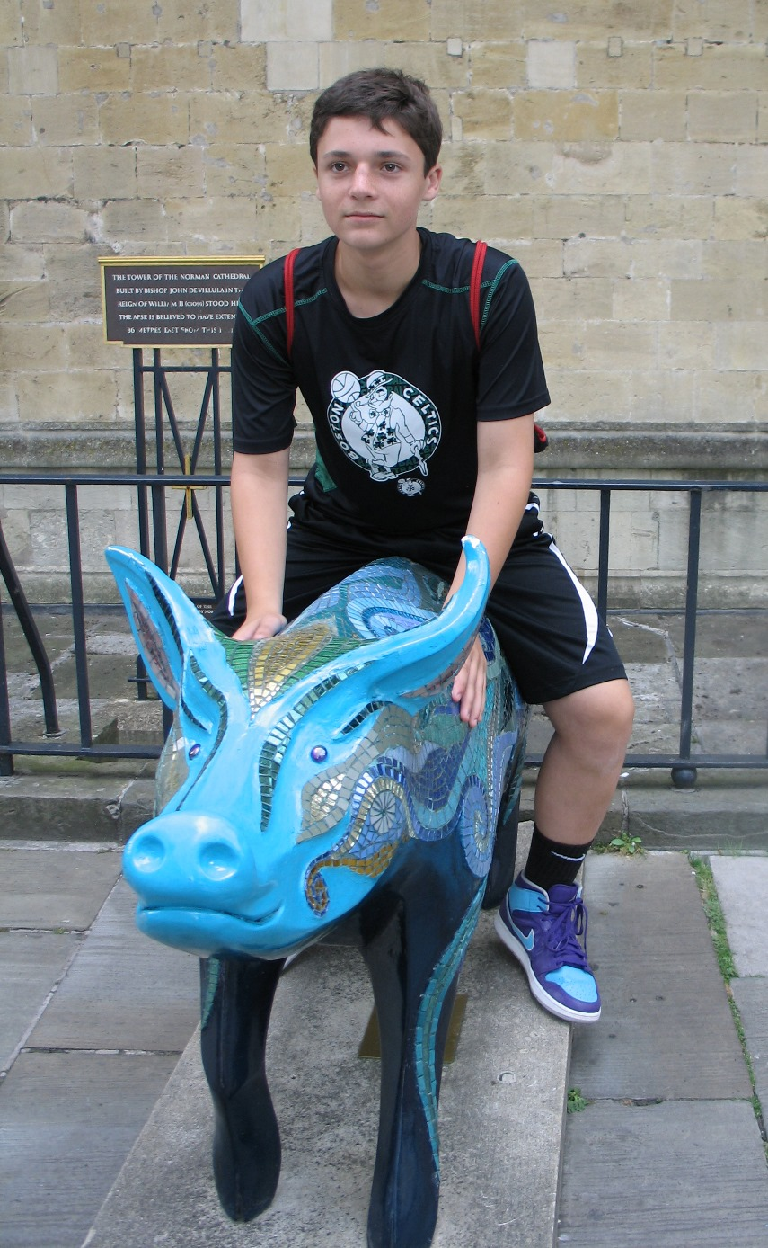 Nathan riding a blue pig