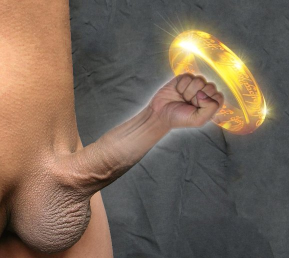 Nude male body somewhat lacking in bellybutton and other expected abdominal features, with completely shaved pubic hair and erect penis. Instead of the upper portion of the shaft and head, a clenched fist has been substituted using The GIMP. The whole penis assemblage glows slightly. The fist is haloed by, or about to punch through, the glowing, semi-transparent One Ring.