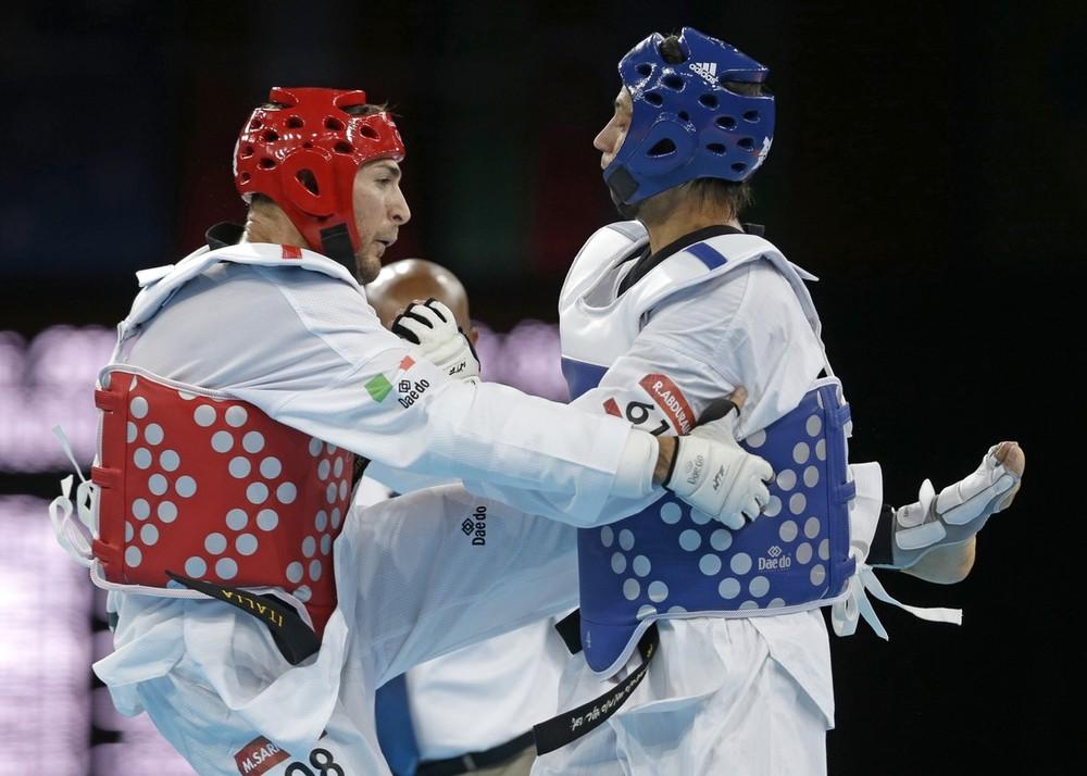 Taekwondo Расул Абдураим (Кыргызстан) против Мауро Сармиенто (Италия) - Kyrgyzstan's Rasul Abduraim fights Italy's Mauro Sarmiento
