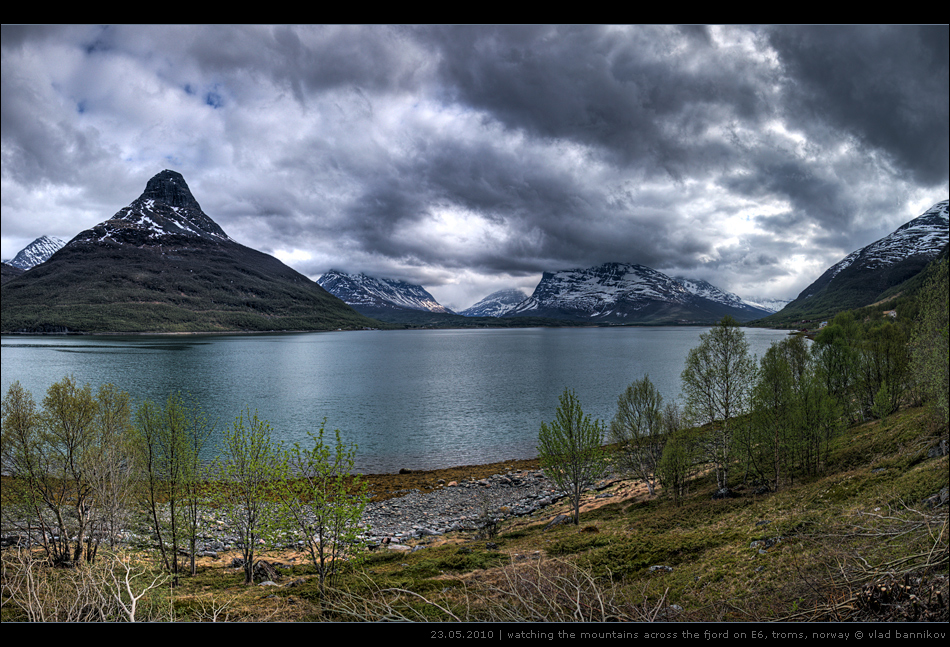 watching the mountains across the fjord on E6, troms, norway | 23.05.2010