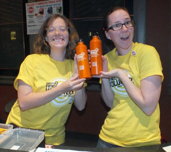 20130805 Two Fringe volunteers holding up water bottles