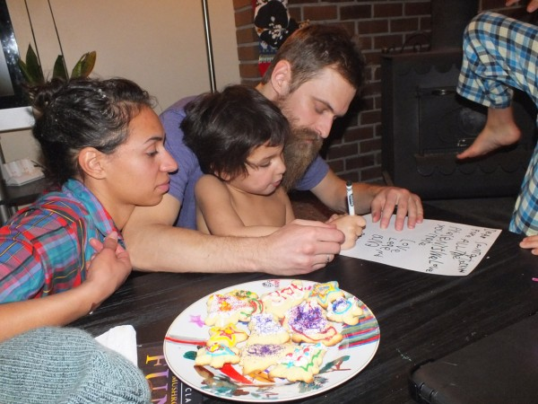 Wenonah and Justin help Bangii sign his name on letter to Santa.  Bend, OR 12/24/12