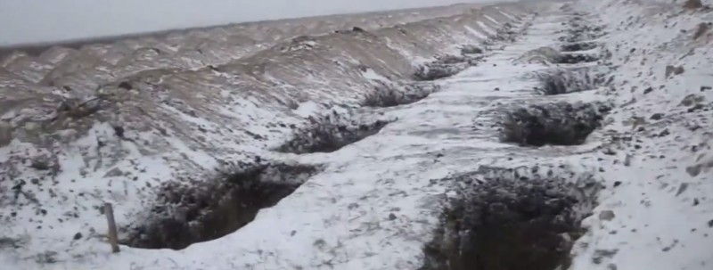 Разрытые могилы для украинцев