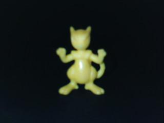 small yellow figure