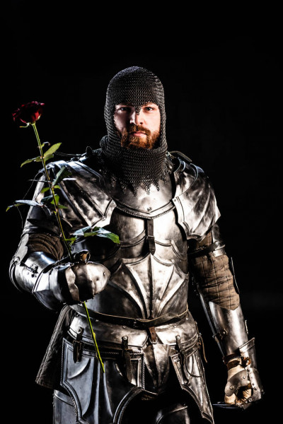 depositphotos_313994968-stock-photo-handsome-knight-armor-holding-rose