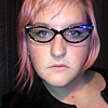 viv with pink hair and a solemn expression