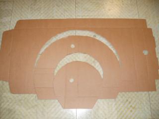 cutout of cardboard shape for brim