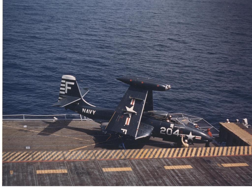 F2H-2BansheeaircraftwithfoldedwingsbyMcDonnellofVC-62isontheflightdeckoftheUSSLakeChamplainCVA-39inKoreanwaters