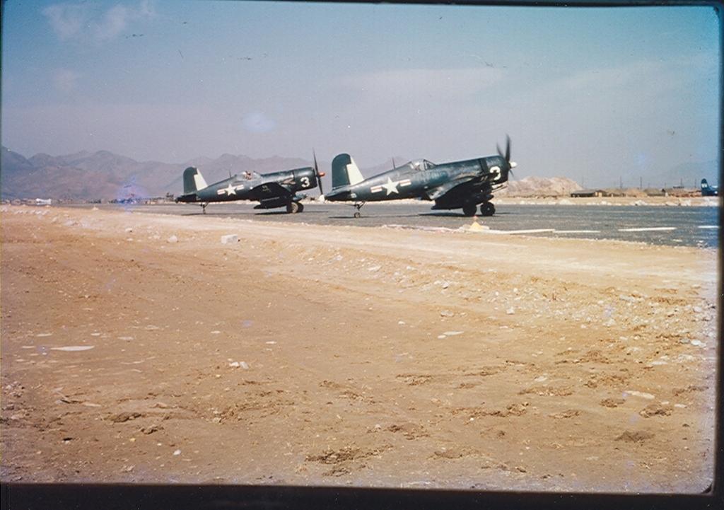 F4U-4BCorsairaircraftofHEDRON-12areonthegroundatK-1Korea