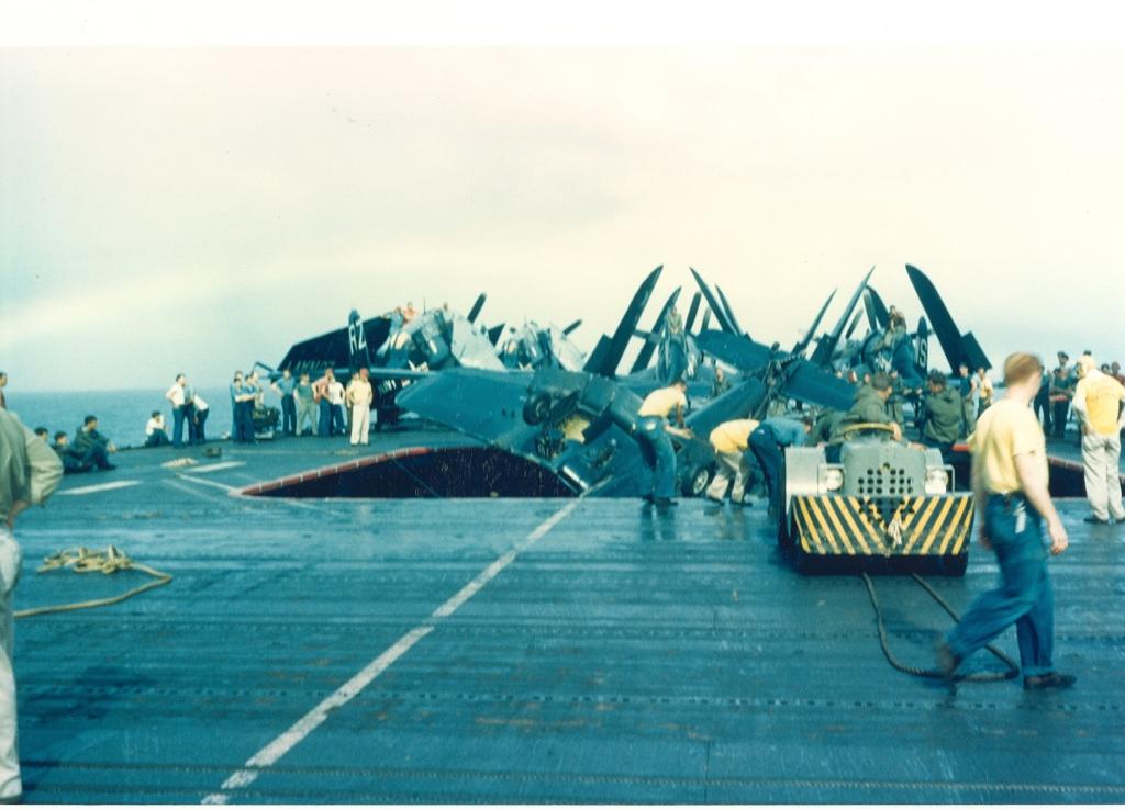 F4U-4CorsairaircraftofVMF-323crashlandedatabarrierontheflightdeckoftheUSSSicily