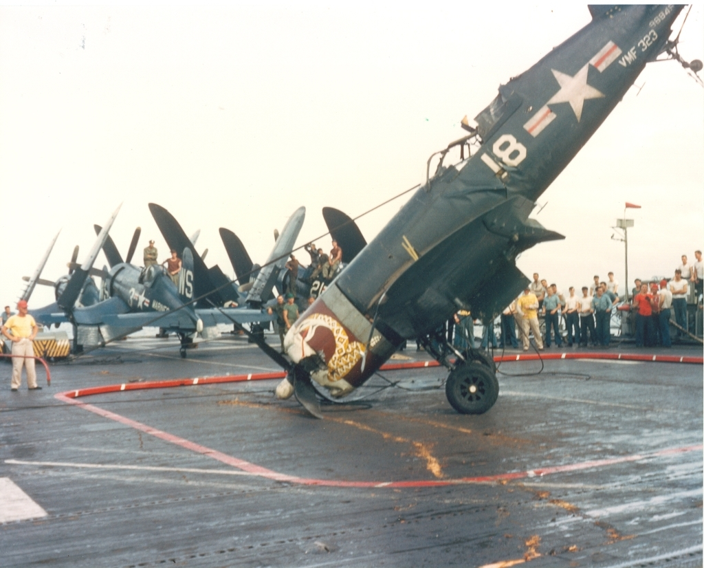 F4U-4CorsairaircraftofVMF-323landiednosetippeddownontheflightdeckofUSSSicilyCVE-118inwatersoffKorea