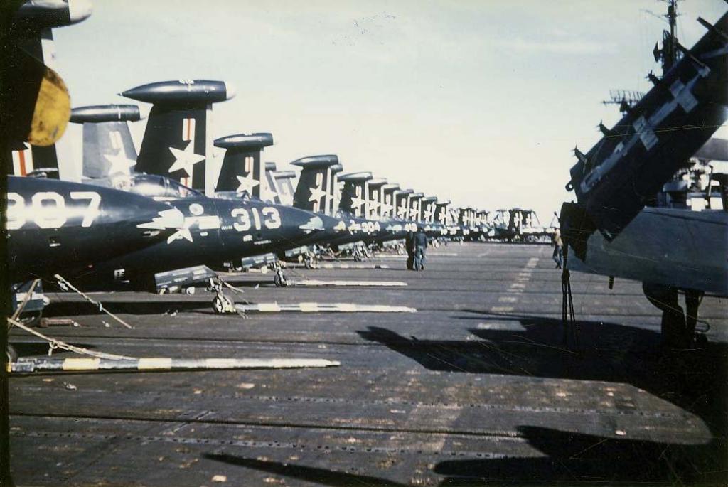 F9F-2BPanthersofFighterSquadronVF831withtowbarsattachedtotheirfrontwheelsspottedonthedeckofthecarrierAntietamCV36suringabreakinflightoperati