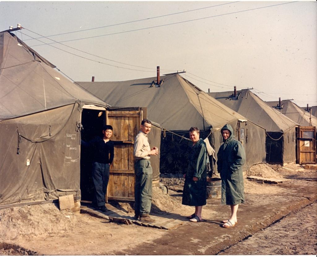 PersonnelstandoutsidelivingfacilitiesatK-1anairfieldinPusanSouthKorea