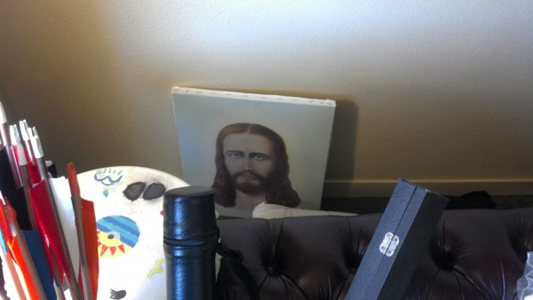 Jesus, behind the couch