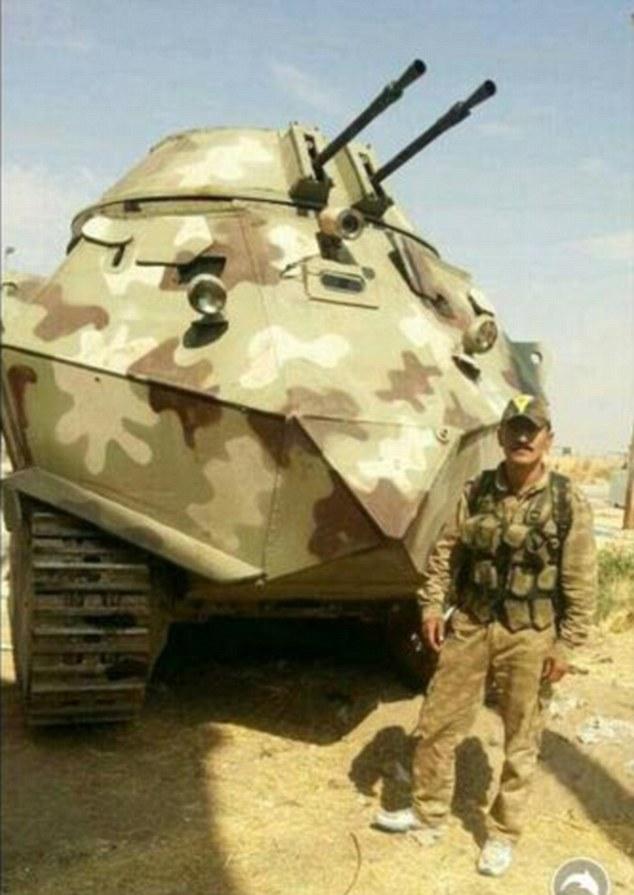 1411990145792_wps_1_Mad_max_Kurdish_fighting_
