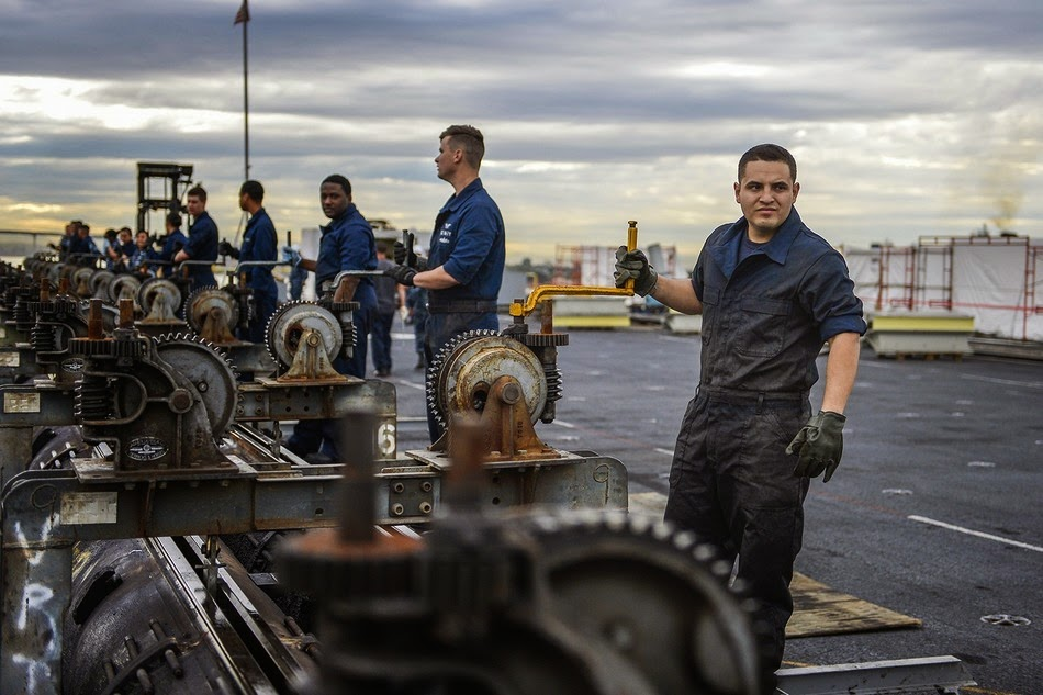 Sailors clean catapult on US Navy USS Ronald Reagan (CVN 76)  1