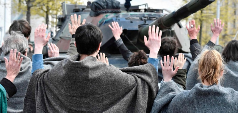 Activists-stand-in-front-of-a-tank