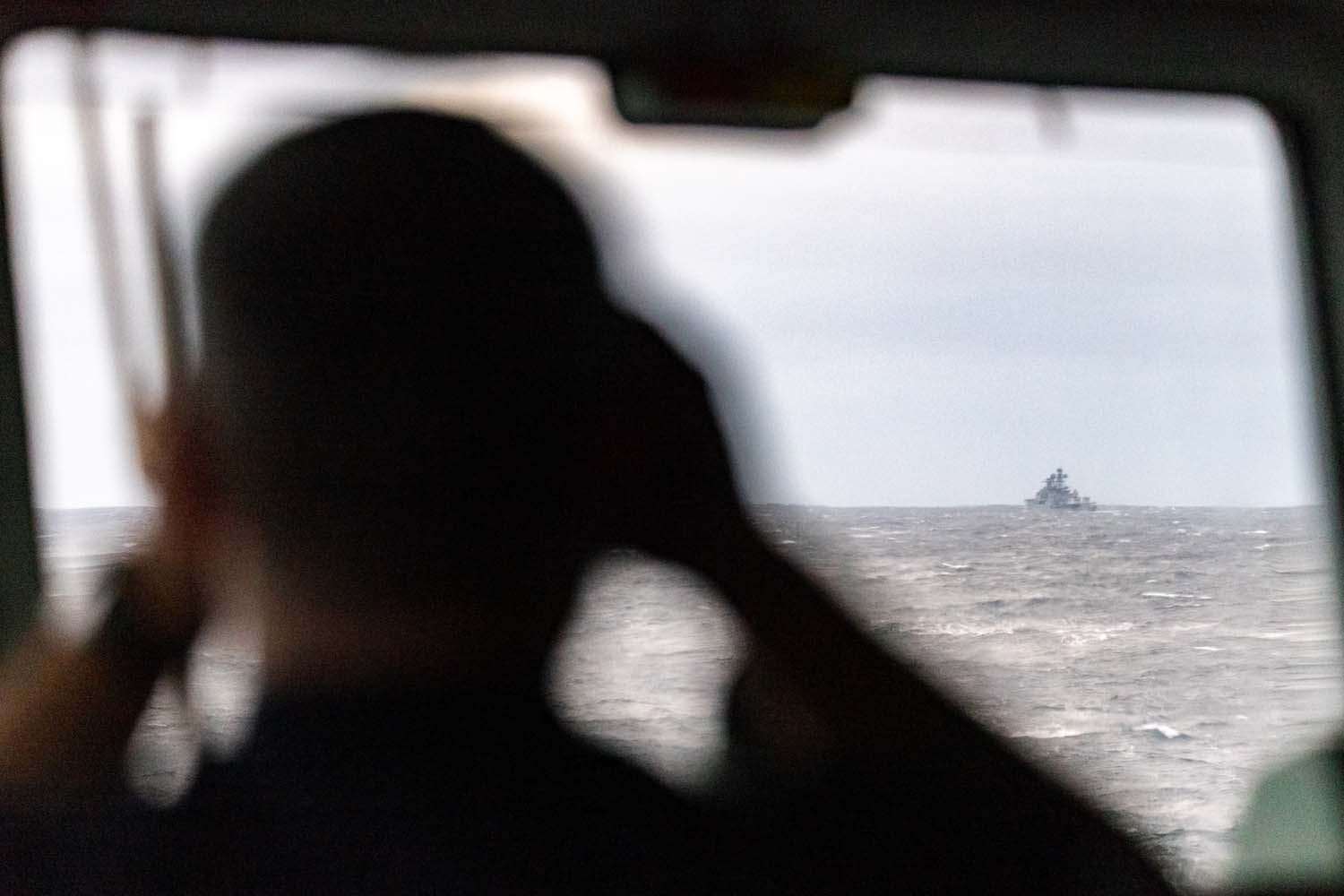 A sailor on board HMS Northumberland monitors the movement of Vice-Admiral Kulakov