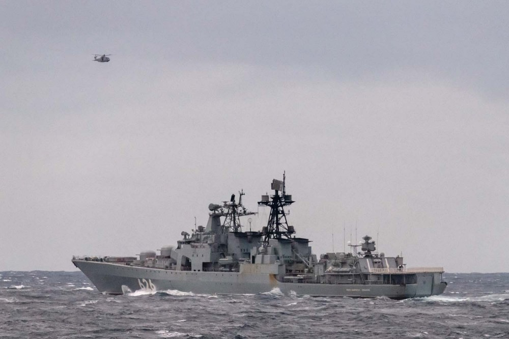 HMS Northumberlands Merlin helicopter monitors ViceAdmiral Kulakov from the sky