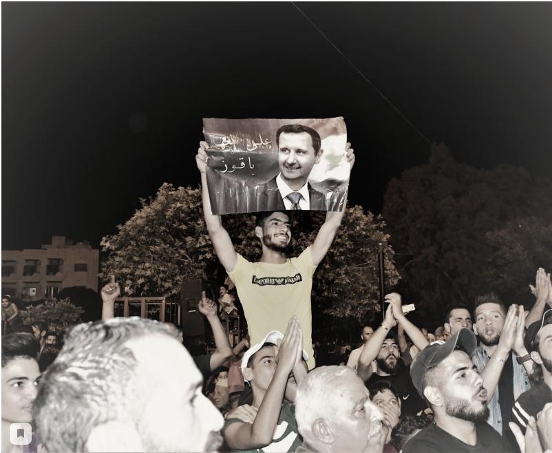 Кабун, ранее находившийся под контролем вооруженных группировок, выступает в поддержку президента Асада. Фото: Ванесса Били