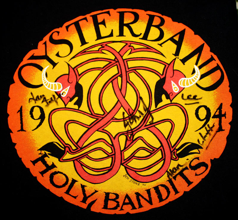 oysterband 1994 tour tshirt, with red demons on orange background