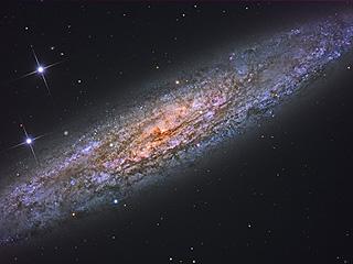 NGC 253, запыленная галактика