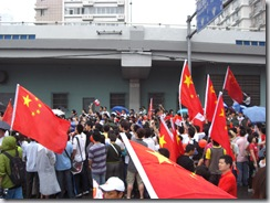 The crowd preparing to see the Olympic Torch Relay in Shanghai.