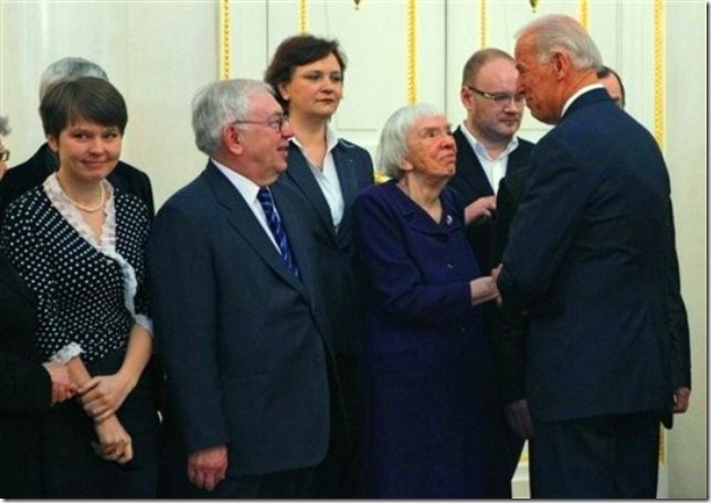 """Vice President of the United States Joe Biden, right, speaks to Russian human right's activist Lyudmila Alexeyeva, second right, as he meets with Russian Civil Society leaders in Moscow,  Russia, Thursday, March 10, 2011. Russia's human rights ombudsman Vladimir Lukin, second left, and environmental activist Yevgenia Chirikova, left.  Biden is on a two-day visit to Russia to assess and develop Washington's """"reset"""" policy with Moscow.  (AP Photo/Alexander Zemlianichenko)"""