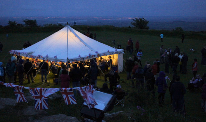 Callington Town Band in a tent on Kit Hill, with Plymouth in the background