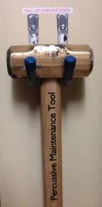 Percussive maintenance meme showing a hammer