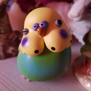 Cute little budgie figurine