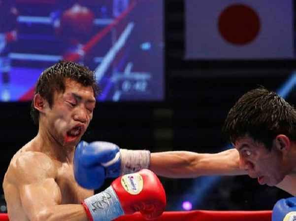 Akira Yaegashi получает удар от Одилона Залеты
