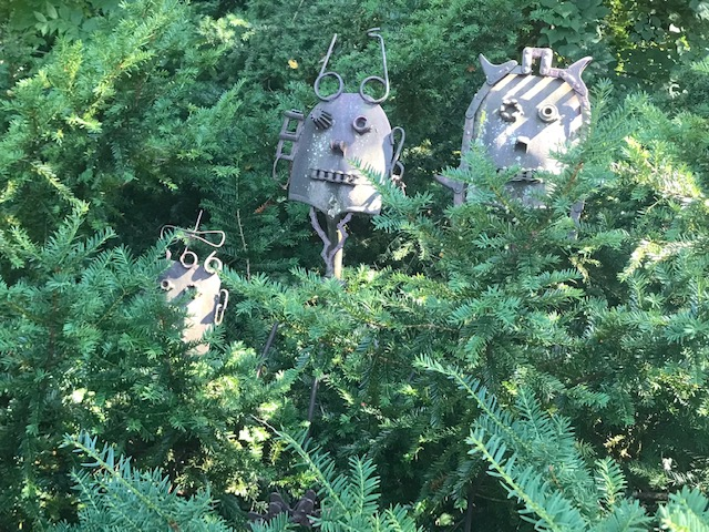 Cute industrial family, waiting, stalking the visitors from their hiding place in the bushes.