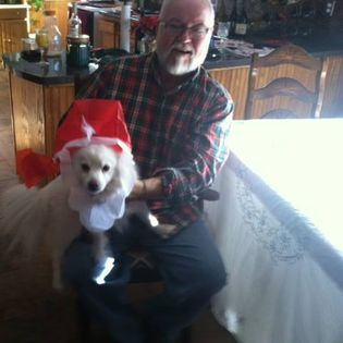 Primo & his papa--his favorite human ever! (Papa just did a holiday magic trick in this photo & Primo was his assistant).