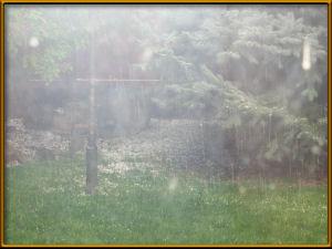 Hail falling as seen through livingroom window