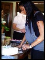 Kristin cutting cake at Baby Shower