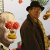 A-visitor-walks-past-Premonition-of-a-Plague-by-Nicholas-Jolly-at-the-London-Art-Fair