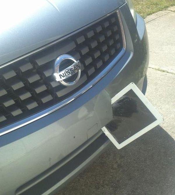1366053490_ipad_stuck_in_car_bumper_03_1