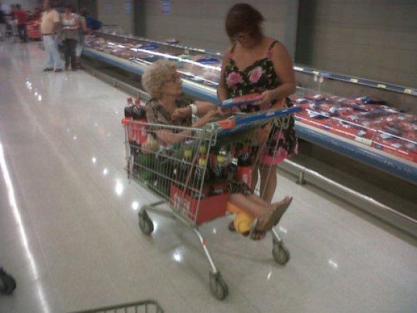 d2546257d0de41ccc38fd1d4d4128014-woman-has-old-lady-in-her-shopping-cart