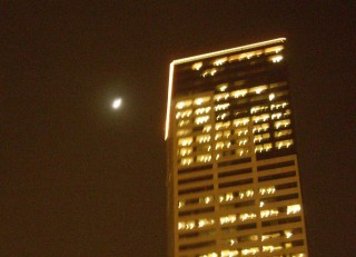 The moon and the US Bank/Unico Building, Portland's second-tallest building. Also known as 'Big Pink.'