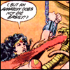 Wonder Woman, hanging from a chain in manacles, says 'But an Amazon does not die easily!'