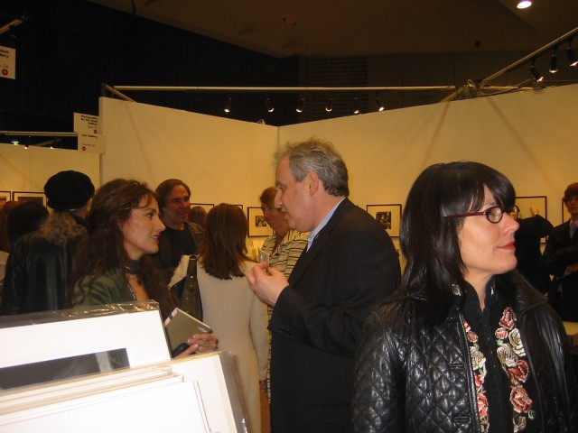 Photo L.A. Organizer, gallerist Stephen Cohen, doing business on a bustling Photo L.A. 2006 opening night