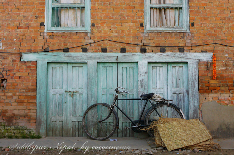 Courtyard with a bicycle in Siddhipur, Nepal, Kathmandu Valley 2011