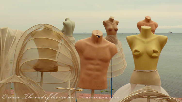 Crimea. The end of the season. Mannequins on the background of the Black Sea, Feodosia