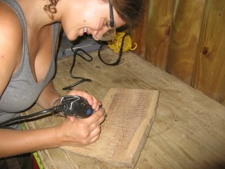 Erin making a sign, this was one of the projects we did to help out of the Finca