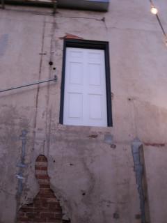 The door on the second floor.