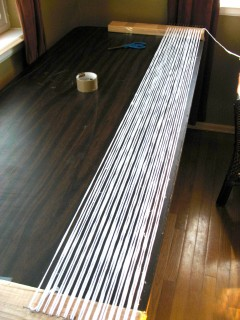 Stringing the loom