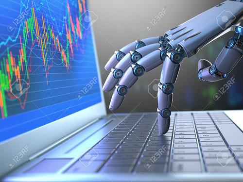 53908030-Robot-hand-ordering-on-a-laptop-keyboard-an-exchange-trade--Stock-Photo.jpg