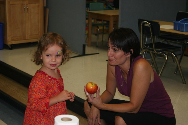 Gwen giving Mary Lou an apple