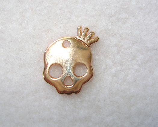 golden skull pendant